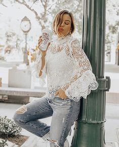 Looking for a more laid back casual look but don't wait to sacrifice wearing lace? Pair it with some ripped jeans, statement earrings and a messy updo! #whiteoutfit #lacetop #datenightoutfit #feminestyle #denim #crochet #fashion #rippedjeans