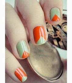 love the green and orange triangles in this mod manicure.