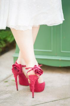 Sassy Red Shoes --    See More on  http://www.StyleMePretty.com/2014/01/28/bohemian-garden-wedding-inspiration/  Photography: Twah Dougherty - www.styleartlife.com
