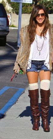 Ashley Tisdale rocking the knee high sock and boot trend.