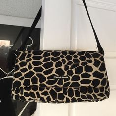 Giraffe spotted shoulder bag Black and taupe colored shoulder bag, hot pink lining. 2 zip pockets on inside. Magnetic snap on flap. Footed bottom. 2 small spots on very bottom. Pic.4 Frankie & Johnnie Bags Shoulder Bags
