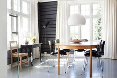 Anette and Fredrik started with the wood floors (run down after generations of use) by painting them a light gray throughout the house.