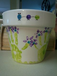Mothers Day flower pot art! Handprint flowers of all the kids :)