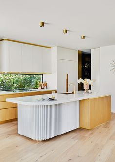 Forget taking a trip to Palm Springs—if you need a Mid-Century fix, just pop over to Ella Edwards' Melbourne home. Drawing inspiration from the iconic Parker Hotel in Palm Springs, Ella's abode is a breathtaking ode to the modernist design movement. We love her clean white kitchen with gold fixtures.