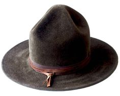 Mountie Hat Rangers Hat Pharrell Hat Smokey The Bear Hat Canadian Mountie Campaign Hat Wide Brimmed Hat Scout Hat Fall Fashion Mens Hat SAMPLE SALE This style is based on the hat worn by park rangers in America. The picture shows Brown velour furfelt, ready to ship! No other colors at this price. Crown height: 6.5/16.4 cms Brim width: 3.25/8.3 cms Hatband: 1 inch wide ribbon, and a hand cut genuine leather strap. To see more hats, please click: http://www.etsy.com/sh...