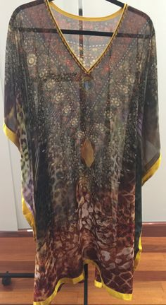 Beautiful sheer Indian kaftancollection in a very generous free size:        outer width 106cm (seam to seam)  inner width 66cm (stitch to stitch) or 132 cm circumference - this should fit up to AU size 26  length 107cm        Made in India            They are stunning, fashionable long flowing garments with long sleeves. These trendy kaftansare available in various bright and vibrant colours.        A kaftan is now a must-have in any wardrobe thanks to its classic cut and multiple…