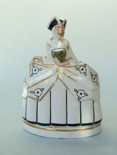 Venetian Perfume Lamp  French ceramic Venetian style lady in a tricorn hat. She holds a bunch of flowers which is the perfume holder bowl and is beautifully hand painted. Total height is 8 inches