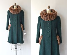 Gorgeous vintage 1930s dark green boucle wool coat with large sheared fur collar and trim, princess seams, large wool covered buttons and silk lining.