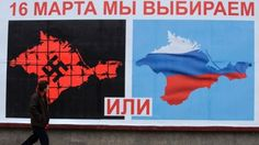 """A man walks past a poster reading """"On March 16 We Vote Or,"""" in Sevastopol, Crimea, Ukraine. #US, #UK and #EU denounced the intervention by #Russia in #Crimea and say the borders of #Ukraine, a country of 46 million people, should remain unchanged. Western powers will not accept the outcome of Sunday's referendum."""