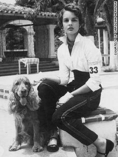 Carolina Herrera, aged 16, with her cocker spaniel, Red, at a dog show in Caracas, Venezuela