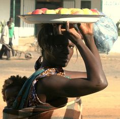 """""""Woman with apples Zambia""""  Apples?? Really??  I bet they were mangoes!  I don't remember apple orchards when I was there,  Too hot for Apples to grow well in Zambia."""