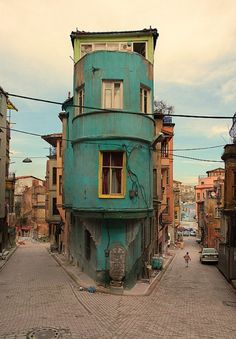 we decided that yes, our home should be lime green. and verdigris. with canary yellow window frames and royal red curtains. and we'd live just up the road from the harbour. and cool music would flow down like a waterfall of joy. (Fener neighborhood, Istanbul, Turkey)