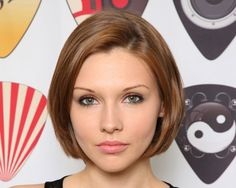 layered graduated bob | The layers are cut at a soft angle, a little above her chin. A smart ...