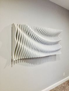 This parametric wall wave is a visually intriguing piece of wall art. Comprised of 34 individually cut pieces of 3/4 Oak plywood that spaces apart to displays a sweeping and organic wave. This piece is 58 long, 28 wide, and 8 thick at its thickest. It requires assembly but is