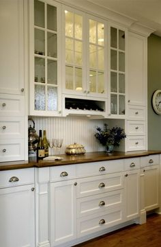 Like this glass and also like the hardware on these cabinets