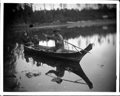Quatsino Indian family in canoe Photographer/Studio: Leeson, Ben W. Content: Note on copy negative envelope, 'Korpreno Tom or Sealing Tom showing young Indian son how to throw a double pronged sealing spear.' Topic: Kwakiutl Indians Indians of North America - Boats Children Person: Korpreno Tom Location: British Columbia - Quatsino