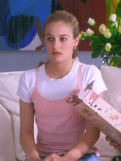 Costume designer Mona May gave the characters of Clueless iconic wardrobes plucked from her imagination, and some of the looks she created have made it back into the mainstream. In honor of 21 years of Clueless, here are seven it-girl-approved trends that you can wear today. Shown is the layered slip trend. Baby tees worn under slip silhouettes are everywhere again, thanks to that aforementioned '90s resurgence (and Anna Sui).