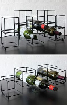 13 Wine Bottle Storage Ideas For Your Stylish Home | A single one of these matte black geometric wine racks lets you store 5 bottles of your favorite wine, but stack more of the holders on top of each other and you can store as much wine as you like.