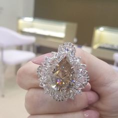 Pear of the day goes to @mogulgemsdubai with eye catching fireworks that melt #MyLoveAffairWithDiamonds and not to mention that halo of rose cut and old mine cut diamonds! #ChampagneGem200KSpecialEdition