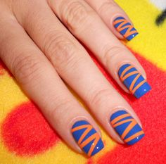 Orange and Blue Nails via The Sugar Cube