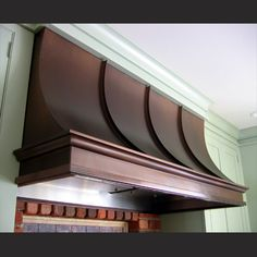 Wall mount copper range hoods featuring an antique finish. Custom range hoods fabricated to order in copper, zinc, steel, stainless steel and more. USA made