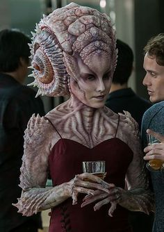 """Natalia was an alien woman who spoke with Ensign Pavel Chekov at James T. Kirk's thirtieth birthday party. She was informed by Chekov that Scotch whisky had been invented by """"a little old lady from Russia."""" (Star Trek Beyond)"""