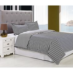 @Overstock - Keystone Cotton 300 Thread Count 3-piece Duvet Cover Set - A wide navy blue and white stripe pattern infuses nautical style into this refreshing Keystone duvet cover set. Crafted with a thin stripe reverse, this on-trend bedding set is designed with soft cotton and is fully machine washable.  http://www.overstock.com/Bedding-Bath/Keystone-Cotton-300-Thread-Count-3-piece-Duvet-Cover-Set/9240540/product.html?CID=214117 $85.99