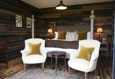 Cosy wooden cabin in dark wood cladding