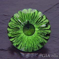 """Did you know that ancient Romans called #peridot the """"evening emerald,"""" because its green color did not darken at night, but was still visible by lamplight? Photo: Richard P. Homer. Courtesy: Gems by Design, Inc."""