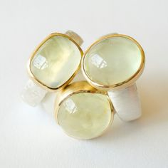 We love these prehnite silver and gold rings    www.hoogenboombogers.com