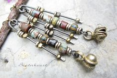 Que sera... artisan earrings primitive tribal boho jewelry assemblage  brass bell picassso czech beads