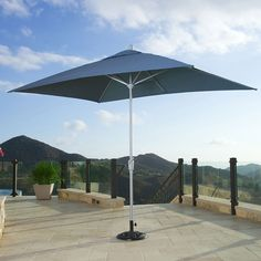 Portofino Comfort Dining Umbrella in Newport Blue - enjoy games, a meal, or conversation in your outdoor dining area while staying out of the sun!