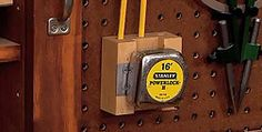 Tape measure holster includes pencils  Would be easy to adapt to a french cleat wall.