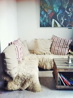 Stacked shipping pallets covered in cozy sheepskins transform any corner into a relaxed lounge <3