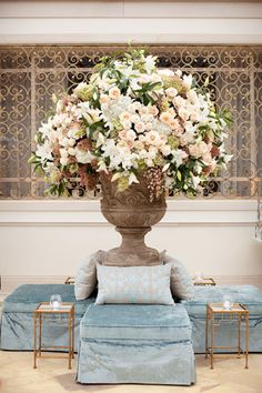 A gorgeous floral arrangement  as the focal point for a luxe wedding lounge. #wedding #flowers.