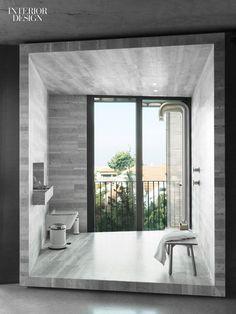 This serene bathroom is surrounded in honed Carrara marble.   Uri Michael Palan Draws on Pierre Koenig for Tel Aviv Apartment