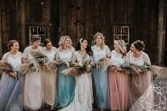 The bride chose these skirts + individual lace tops with each bridesmaid in mind. She had each gal rock a specific color that reminded her of them. How fun is that? See more from this pastel-hued barn wedding with all the gemstone accents Rustic Bridesmaid Dresses, Bridesmaid Separates, Lace Bridesmaids, Bridesmaid Bouquet, Alternative Bridesmaid Dresses, Bohemian Bridesmaid, Tulle Wedding, Lace Weddings, Wedding Dresses