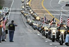 The Patriot Guard Riders motorcycle group precedes the casket
