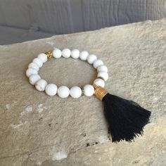 White beaded stretch bracelet with tassel by TracisBeads on Etsy