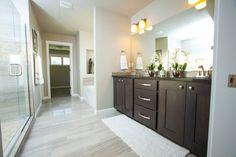 Redwood- Master Bath featuring tiled floors and shower, double sinks, brush nickel plumbing fixtures and cabinet knob upgrades.