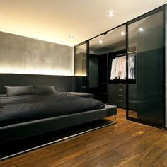 Masculine closet by Architology.