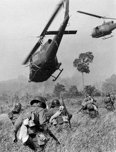 US Army helicopters fire into a tree line to cover the South Vietnamese ground troops in March 1965.
