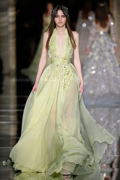 Long A line dress in lime chiffon with a plunging neckline and nipped waist, embroidered with 3D floral appliques | Couture Spring 2015