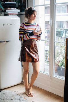 """Sunday: """"The one thing I suggest you have in your closet this winter? A striped sweater. French women are known for wearing Breton stripes, but I like to experiment with different colors. Here the brightness makes the skirt more exciting."""" Ganni top, $205, Need Supply Co."""