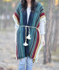 I'm so excited to share this colorful pattern with you today! This crocheted ruana is so comfortable and I think it has a wonderfully unique yet laid back look. The inspiration for this piece comes from the colorful serape shawls and blankets found in Mexico. You might remember the Native Stripes Knit Blanket that I made which was also inspired by the gorgeous serape, but it's been a while since I've used color in this way! This beautiful alpaca blend yarn from Lion Brand also g...