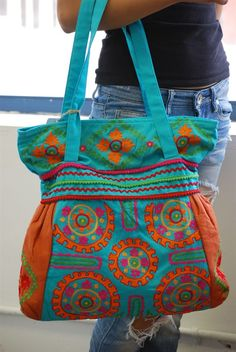 Turquoise Embroidered Bag from Barbwire Roses in San Angelo TX! Cute stuff at affordable prices! Check out their online site by clicking on the pin!!!!
