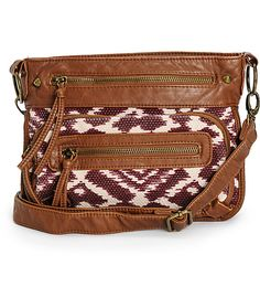 Keep your essentials organized with the style of this small size crossbody purse that features a burgundy ikat woven exterior finished with cognac leather trim detailing.