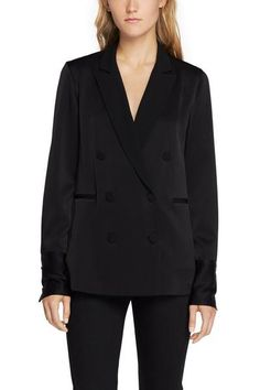 """Classic tailoring-inspired blouseSatin-back crepeClassic fitFabric-covered button closuresSleek tuxedo-inspired detailsDry clean onlyModel is 5'9"""" wearing size 2"""