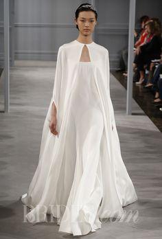 "Brides.com: Spring 2014 Wedding Dress Trend: Sleek and Modern. ""Tatiana"" silk white wedding dress with 4-Ply silk crepe illusion neckline seamed sheath with silk white 4 Ply silk crepe cape, Monique Lhuillier See more Monique Lhuillier wedding dresses."