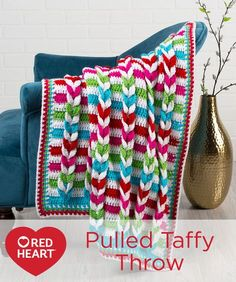 Pulled Taffy Blanket Free Crochet Pattern in Red Heart Yarns -- This unique braided stripes blanket design is brightly colored to keep baby happy, while being sophisticated enough to add the perfect pop of color to an adult relaxing space. So we've shown it in a baby size blanket but also included instructions for a larger size throw.